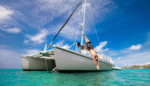 Tropical Vacation: Man Diving Off Sailboat